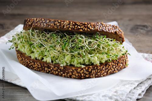 Fényképezés  Sandwich with avocado and alfalfa sprouts