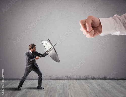 Fotografie, Obraz  Little business man challenges big problems fighting with shield and sword