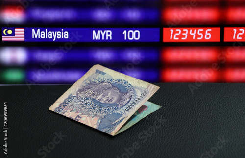 One Ringgit Banknote Of Malaysia On The Black Floor Digital Board Currency Exchange Money