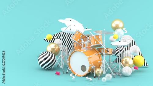 Fotografia, Obraz Orange drum amidst colorful balls on a blue background