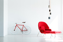 Red Bicycle And Armchair Under...