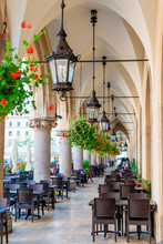 Beautiful Street Cafe, Located In The Arch Of Shopping Arcades In The Center Of Krakow In The Square