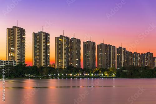 Foto op Aluminium Buffel Landscape building modern business district of bangkok at twilgiht sky, beautiful water reflection.