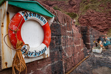 Lifebuoy And Fishing Gear At Pennan Harbour In Aberdeenshire,Scotland.