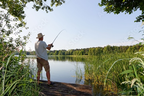 Fotografie, Obraz  fisherman catching the fish durring sunny day