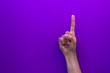 canvas print picture - One counting right hands isolated on purple background
