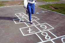 An Adult Girl Passed By The Hopscotch And Decided To Jump