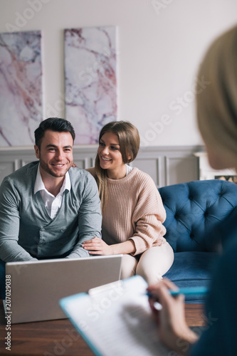 Obraz na plátně Family meeting real-estate agent for house investment.