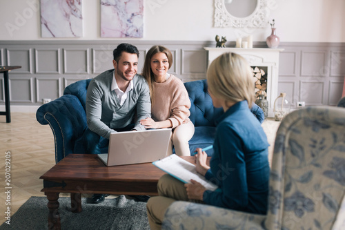 Valokuva  Successful agent giving consultation to family couple about buying house