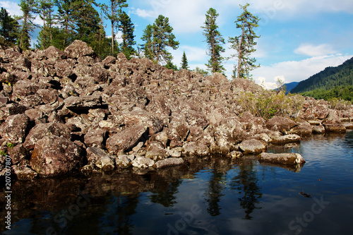 Fotobehang Natuur Park A bunch of stones near the water, Teletskoye Lake, Altai