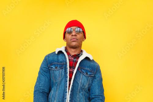 Fotografija  Confident trendy ethnic man on yellow