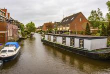 Canal And Housing Surrounding It. Alkmaar Netherlands Holland