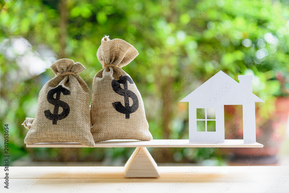 Fototapety, obrazy: Home loan / reverse mortgage or transforming assets into cash concept : House paper model , US dollar hessian bags on a wood balance scale, depicts a homeowner or a borrower turns properties into cash