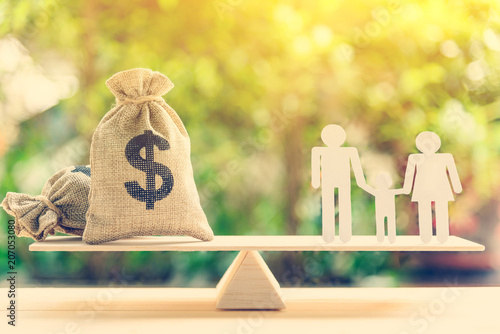 Money saving for kids, family financial wealth management concept : Dollar or cash in hemp bags or burlap sacks and a white paper cut (dad, mom and son) on wood balance scale Poster Mural XXL