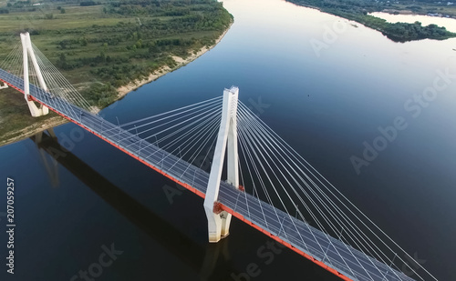 Spoed Foto op Canvas Brug Beautiful bridge over the river. The bridge on the cables is road