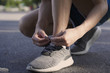 Sportsman hands tying shoelaces for getting ready for Practice. running and sports concept.