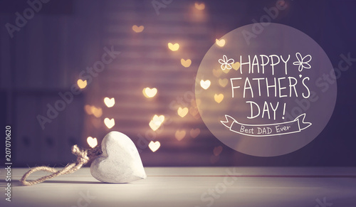 Obraz na plátně  Father's Day message with a white heart with heart shaped lights