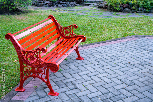 Admirable Bright Red Bench On Brick Patio In A Lush Tropical Garden Gmtry Best Dining Table And Chair Ideas Images Gmtryco