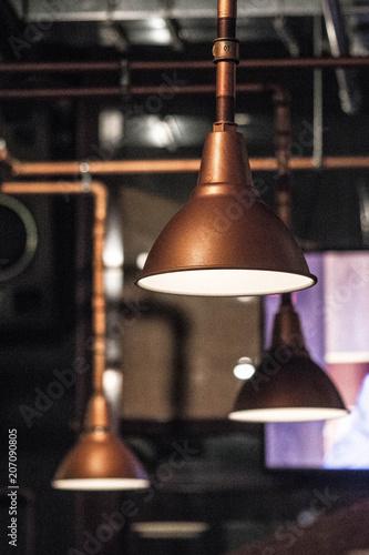Staande foto Industrial geb. Dark grain photo. Pipes and lamp, industrial interior. Grunge style