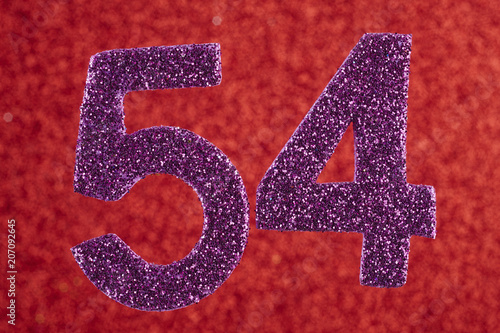 Poster  Number fifty-four purple over a red background