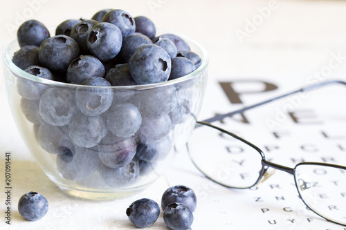 Bilberry cure for eyes concept with glasses Fototapeta