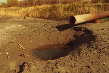 Dirty Water Stems From The Pipe Polluting The River