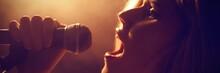 Close-up Of Woman Singing At Concert