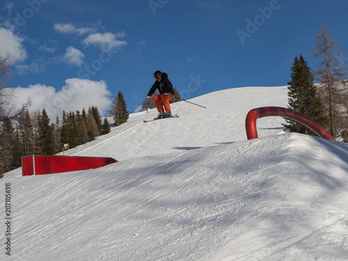 Fotobehang Wintersporten Snowboarder in Action: Jumping in the Mountain Snowpark