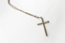Silver Cross With Chain On Whi...