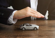 Car insurance concept, Hand man protect a car on the table..