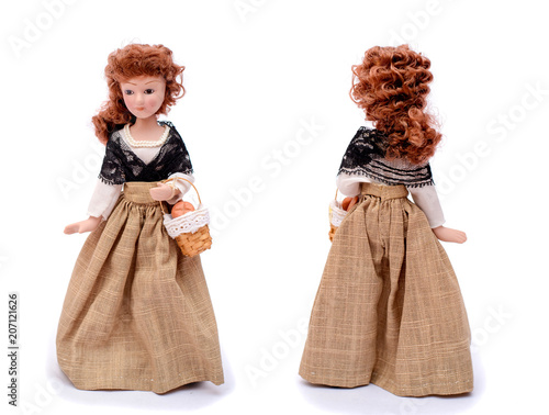 Fotografie, Obraz  Porcelain doll in vintage clothes with a basket, front and back view