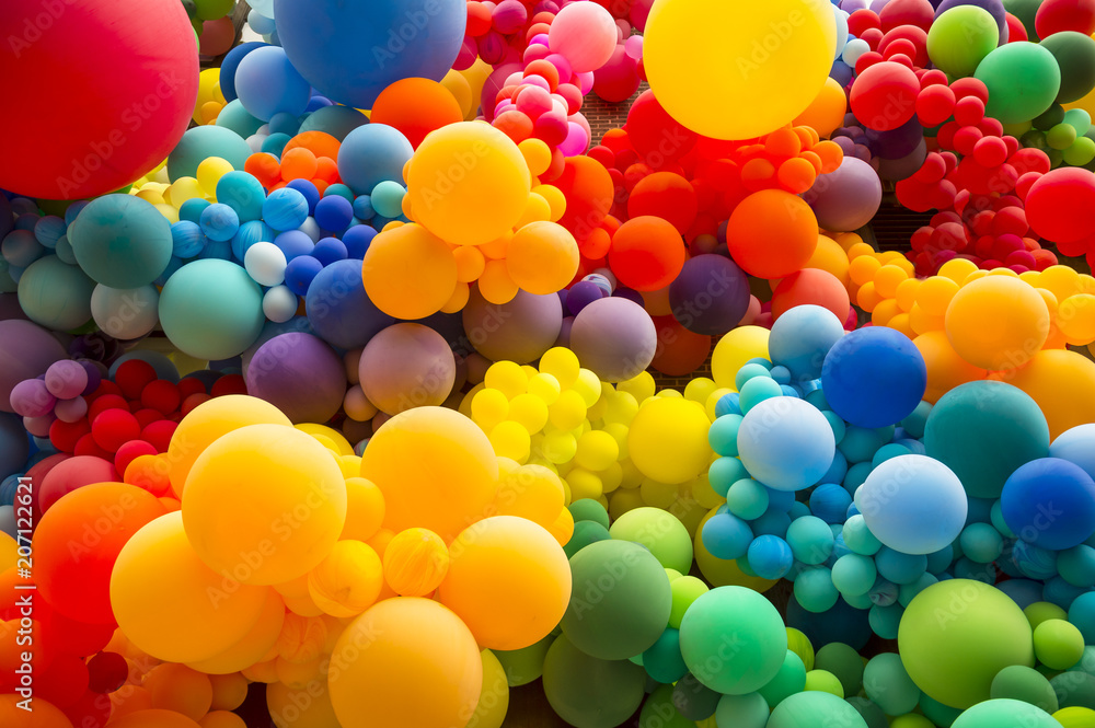 Fototapeta Bright abstract background of jumble of rainbow colored balloons celebrating gay pride