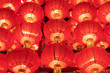 Leinwanddruck Bild - .A row of red lanterns at night