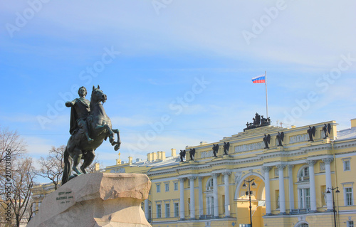 Poster Artistiek mon. Bronze Horseman Monument on Blue Sky Background in Saint Petersburg, Russia. Equestrian Statue of Emperor Peter the Great and Architecture of Senate and Synod Building Facade in St. Petersburg.