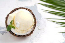 Coconut Ice Cream Scoops In Ha...