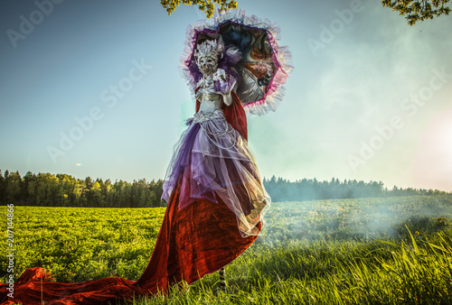 Fotografija Fairy tale woman on stilts in bright fantasy stylization