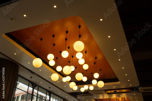 Obraz professional lighting for interior design ball lights hanging from ceiling - fototapety do salonu