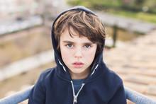 Portrait Of A Boy Wearing A Hoodie