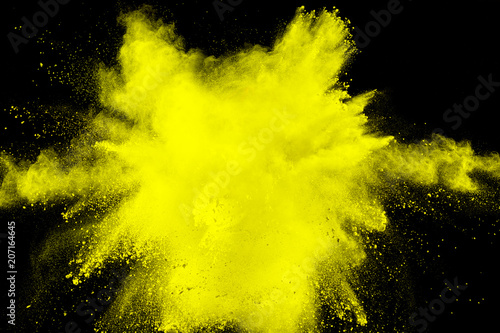 abstract yellow dust explosion on black background
