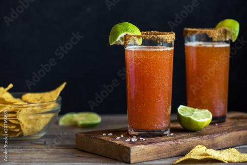 Foto auf Leinwand Bier / Apfelwein Michelada Bloody Beer Cocktail