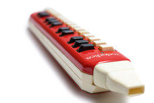 Closeup Of Old German Vintage Red Melodica On White Background