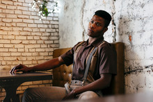 Stylish Male In Classic Clothes Sitting In Cafe