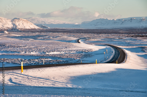 Empty road at sunset in winter landscape of Iceland, European travel destination Poster