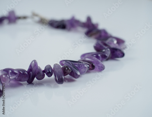 Amethyst necklace fragment isolated on white