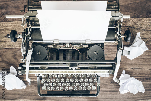 Garden Poster Retro top view of vintage manual typewriter and crumpled sheets of paper on rustic wooden desk