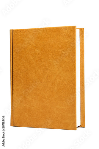 The book is in a bright brown hard leather cover Fototapeta