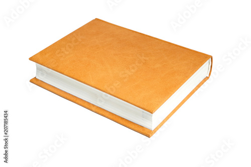 Slika na platnu The book is in a bright brown hard leather cover