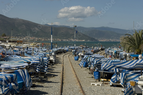 old fishing port, small wooden boats, covered with white and blue striped cloth, Canvas Print