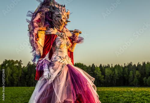 Fototapeta Fairy tale woman on stilts in bright fantasy stylization