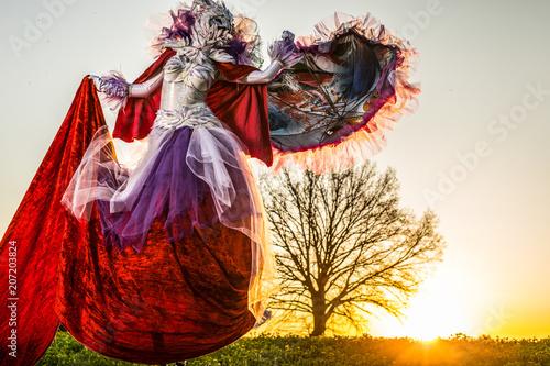 Valokuva  Fairy tale woman on stilts in bright fantasy stylization